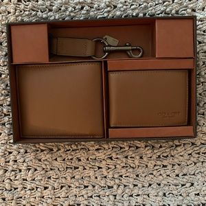 Men's Coach lg wallet, sm wallet and key chain.